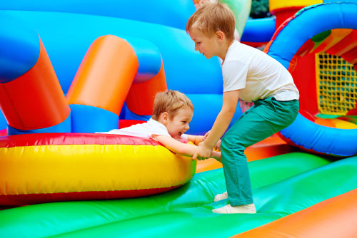 kids playing on bounce house