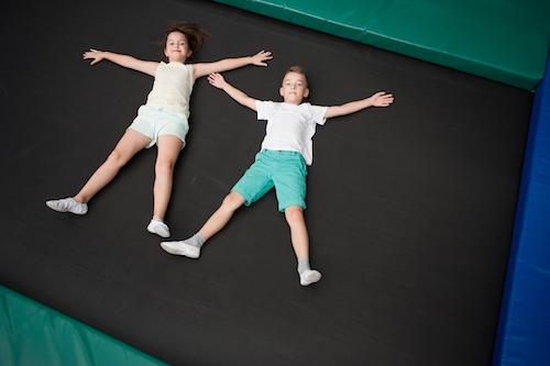 Comparing A Trampoline Park And An Indoor Inflatable Bounce House: Which Is Better For My Kid?